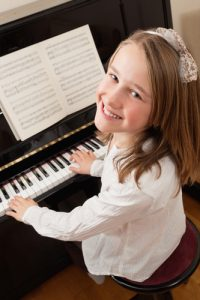 girl practising piano